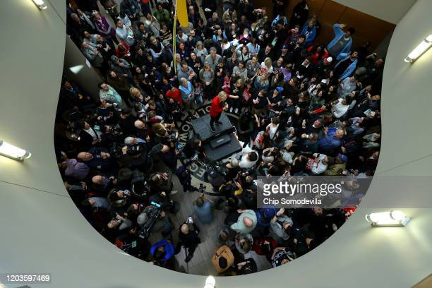 Democratic presidential candidate Sen Elizabeth Warren addresses an overflow crowd in the Kent Campus Center atrium on the campus of Simpson College...