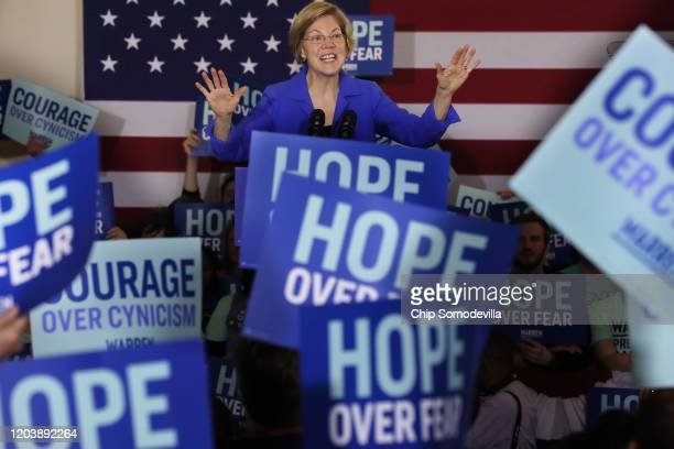 Democratic presidential candidate Sen Elizabeth Warren addresses her supporters during a caucus night rally at the Forte Banquet and Conference...