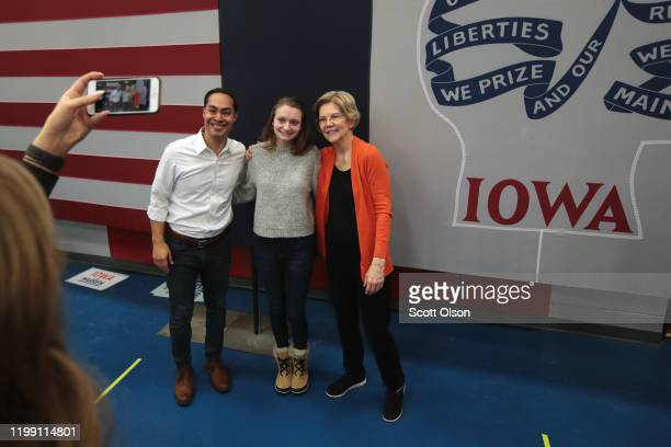 Democratic presidential candidate, Sen. Elizabeth Warren and former housing secretary Julian Castro pose for pictures with guests during a campaign...