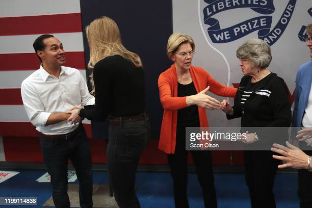 Democratic presidential candidate, Sen. Elizabeth Warren and former U.S. Housing Secretary Julian Castro pose for pictures with guests during a...