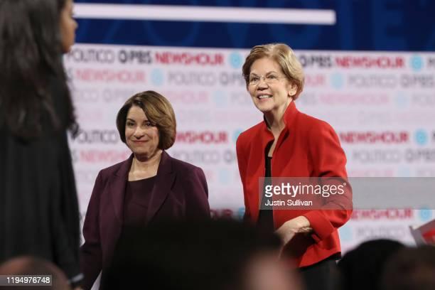 Democratic presidential candidate Sen Elizabeth Warren and Sen Amy Klobuchar walk on the stage after the Democratic presidential primary debate at...