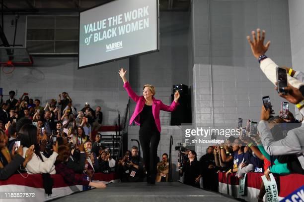 Democratic presidential candidate Sen Elizabeth Warren arrives on stage at a campaign event at Clark Atlanta University on November 21 2019 in...