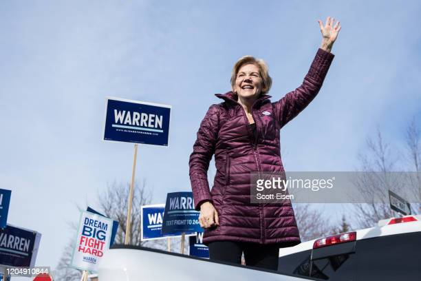 Democratic presidential candidate Sen. Elizabeth Warren delivers remarks to supporters after casting her vote at the Graham & Parks School during the...