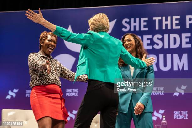 Democratic presidential candidate Sen Elizabeth Warren greets MSNBC host Joy Reid and She The People founder Aimee Allison at the She The People...
