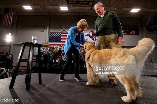 Democratic presidential candidate Sen. Elizabeth Warren , her husband Bruce Mann and their dog Bailey take the stage at the conclusion of a campaign...