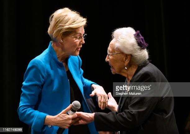 Democratic presidential candidate Sen Elizabeth Warren is escorted on stage by Marcella LeBeau at the Frank LaMere Native American Presidential Forum...