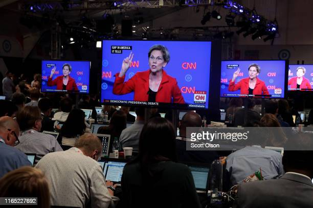 Democratic presidential candidate Sen Elizabeth Warren is shown on television monitors in the press room of the Democratic Presidential Debate at the...