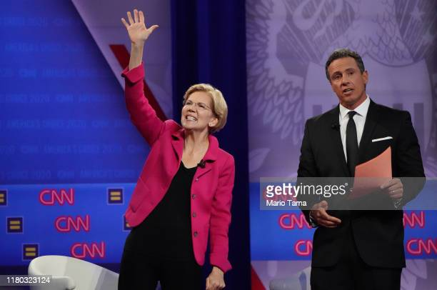 Democratic presidential candidate Sen Elizabeth Warren L waves as CNN moderator Chris Cuomo looks on at the Human Rights Campaign Foundation and...