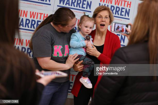 Democratic presidential candidate Sen. Elizabeth Warren poses for photographs with children and their families before a campaign event at Iowa State...