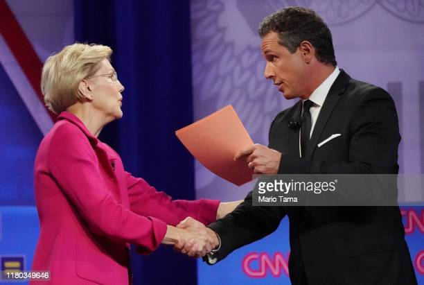Democratic presidential candidate Sen Elizabeth Warren shakes hands with CNN moderator Chris Cuomo at the Human Rights Campaign Foundation and CNN's...