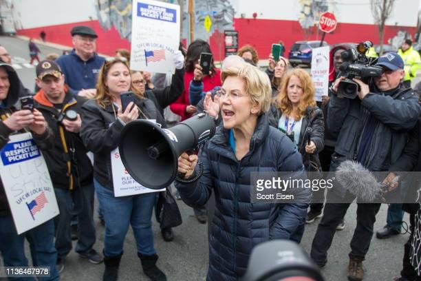 Democratic presidential candidate Sen Elizabeth Warren speaks into a megaphone after joining striking Stop Shop workers on April 12 2019 in...