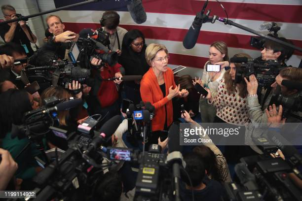 Democratic presidential candidate Sen Elizabeth Warren speaks to reporters during a campaign stop at Fisher Elementary School on January 12 2020 in...