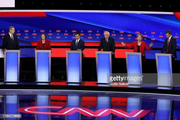 Democratic presidential candidate Sen Elizabeth Warren speaks while Rep Tim Ryan Sen Amy Klobuchar South Bend Indiana Mayor Pete Buttigieg Sen Bernie...