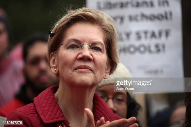 Democratic presidential candidate Sen Elizabeth Warren visits with striking Chicago teachers at Oscar DePriest Elementary School on October 22 2019...