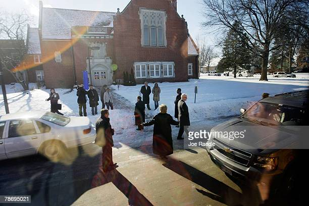 Democratic presidential candidate Sen Hillary Clinton spreads her arms as she leaves an event at the First United Methodist Church January 2 2008 in...