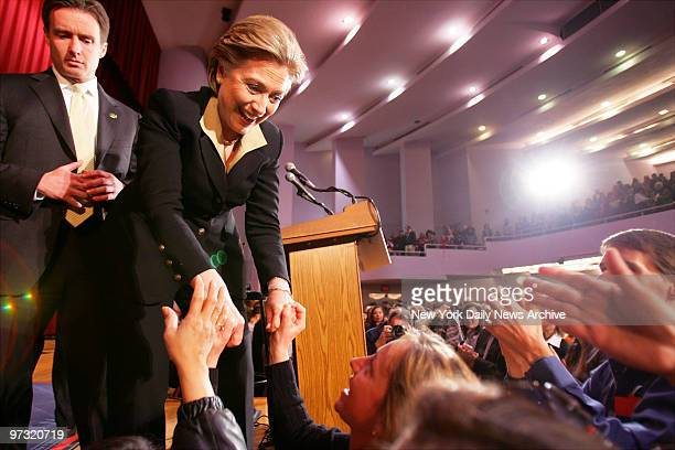 Democratic presidential candidate Sen Hillary Rodham Clinton greets supporters after speaking during a campaign stop at Hunter College before flying...