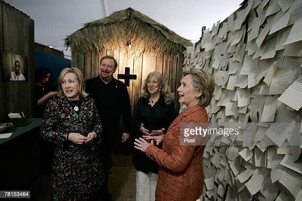 Democratic presidential candidate, Sen. Hillary Rodham Clinton of New York talks with Kay and Rick Warren and Elizabeth Styffe, director of the...