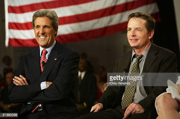Democratic presidential candidate Sen John Kerry and actor/Parkinson's sufferer Michael J Fox smile during a town hall meeting themed on science and...