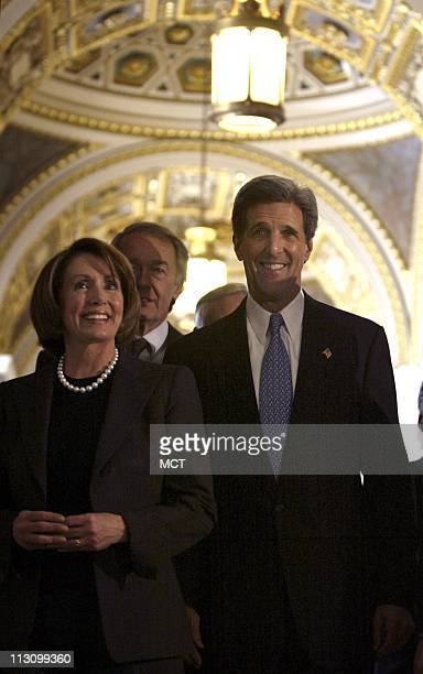 WASHINGTON DC Democratic presidential candidate Sen John Kerry walks with Rep Nancy Pelosi as he goes between meetings of the Black and Hispanic...