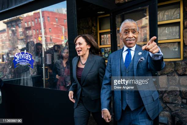 2020 Democratic presidential candidate Sen Kamala Harris and Rev Al Sharpton exit after having lunch at Sylvia's Restaurant in Harlem February 21...