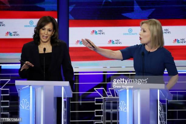Democratic presidential candidate Sen Kamala Harris and Sen Kirsten Gillibrand speak during the second night of the first Democratic presidential...