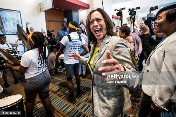 Democratic presidential candidate Sen Kamala Harris dances with a marching band upon arrival at the 2019 South Carolina Democratic Party State...