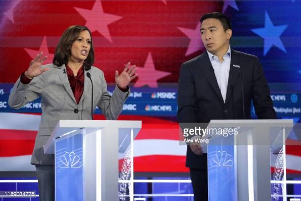 Democratic presidential candidate Sen. Kamala Harris speaks as Andrew Yang listens during the Democratic Presidential Debate at Tyler Perry Studios...