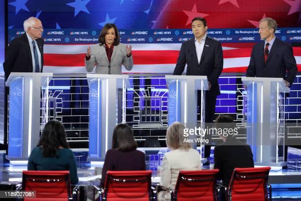 Democratic presidential candidate Sen. Kamala Harris speaks as Sen. Bernie Sanders , former tech executive Andrew Yang, and Tom Steyer listen during...