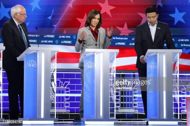 Democratic presidential candidate Sen. Kamala Harris speaks as Sen. Bernie Sanders and Andrew Yang listen during the Democratic Presidential Debate...