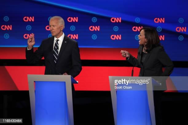 Democratic presidential candidate Sen Kamala Harris speaks while former Vice President Joe Biden listens during the Democratic Presidential Debate at...
