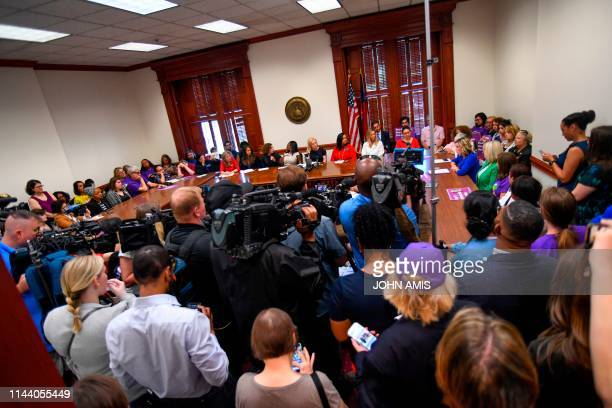 Democratic presidential candidate Sen Kirsten Gillibrand attends a round table discussion held the Georgia State Capitol to speak out against the...