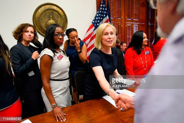 Democratic presidential candidate Sen Kirsten Gillibrand is thanked as she attends a meeting at the Georgia State Capitol to speak out against the...