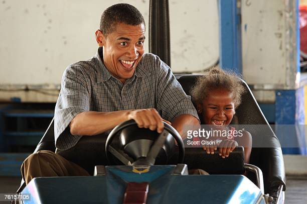 Democratic Presidential Candidate Senator Barack Obama drives a bumper car with his daughter Sasha at the Iowa State Fair August 16 2007 in Des...