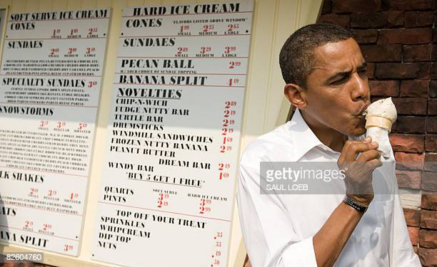 Democratic Presidential Candidate Senator Barack Obama eats an ice cream cone while preparing to board his bus at the Windmill Ice Cream Shop in...