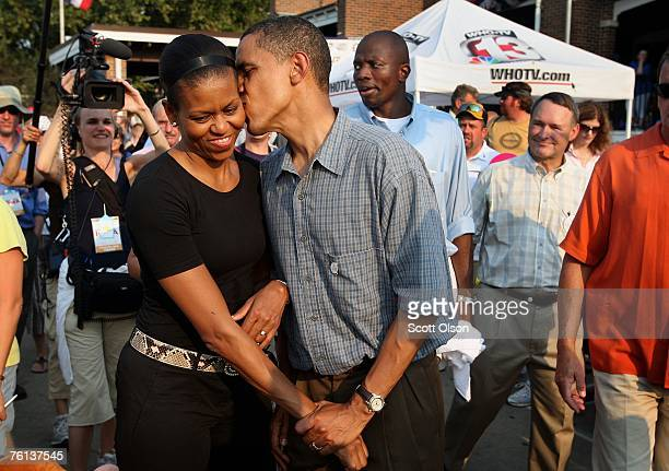 Democratic Presidential Candidate Senator Barack Obama gives his wife Michelle a playful kiss as they tour the Iowa State Fair August 16 2007 in Des...
