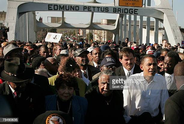 Democratic Presidential candidate Senator Barack Obama marches with a crowd across the Edmund Pettus Bridge to commemorate the 1965 Bloody Sunday...