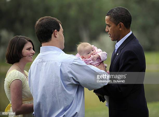 US Democratic presidential candidate Senator Barack Obama meets with Montana residents Matt Kunz his wife Sandy and infant daughter Fiona before a...