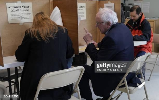 Democratic presidential candidate Senator Bernie Sanders and his wife Jane OMeara Sanders vote at the Robert Miller Community & Recreation Center in...