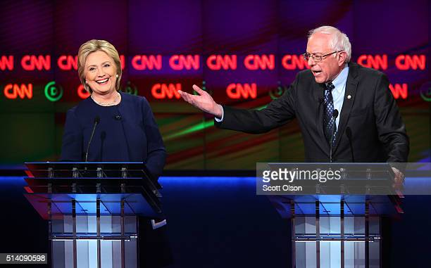 Democratic presidential candidate Senator Bernie Sanders and Democratic presidential candidate Hillary Clinton speak during the CNN Democratic...