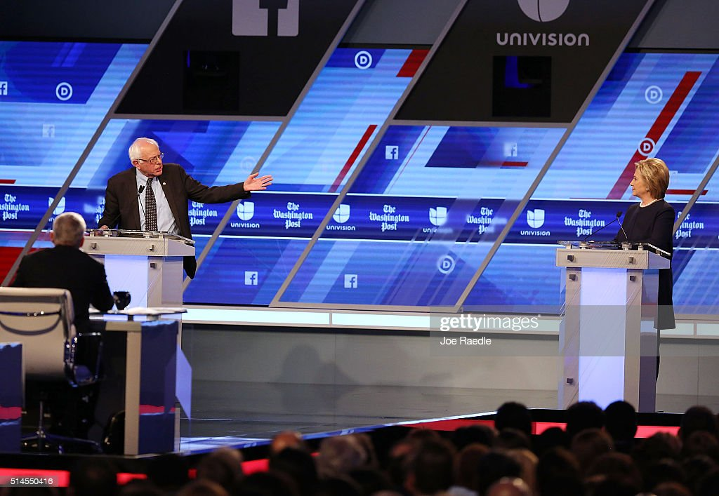 Democratic presidential candidate Senator Bernie Sanders (D-VT) and Democratic presidential candidate Hillary Clinton debate during the Univision News and Washington Post Democratic Presidential Primary Debate at the Miami Dade College's Kendall Campus on March 9, 2016 in Miami, Florida. Voters in Florida will go to the polls March 15th for the state's primary.