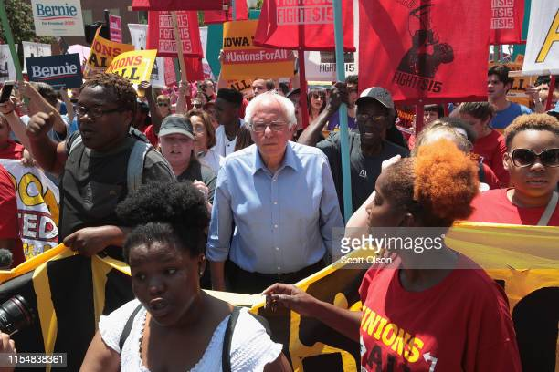 Democratic presidential candidate Senator Bernie Sanders arrives at the Iowa Democratic Party's Hall of Fame Dinner marching with Fight For $15 fast...