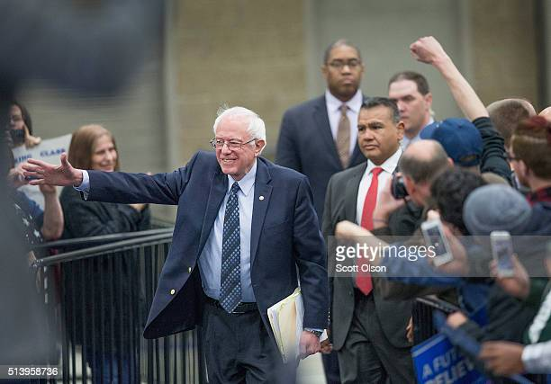 Democratic presidential candidate Senator Bernie Sanders arrives for a rally at Macomb Community College on March 5 2016 in Warren Michigan Voters in...