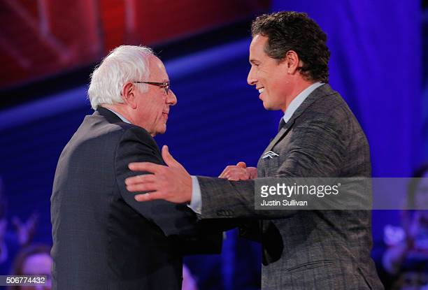 Democratic presidential candidate Senator Bernie Sanders is greeted by moderator Chris Cuomo at a town hall forum hosted by CNN at Drake University...