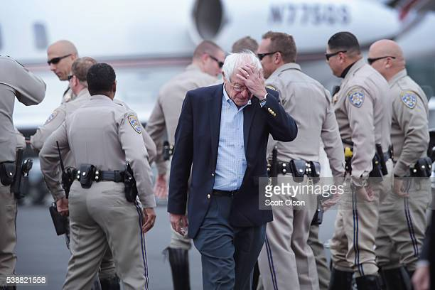 Democratic presidential candidate Senator Bernie Sanders prepares to board a flight from Los Angeles back to Vermont on June 8 2016 in Los Angeles...