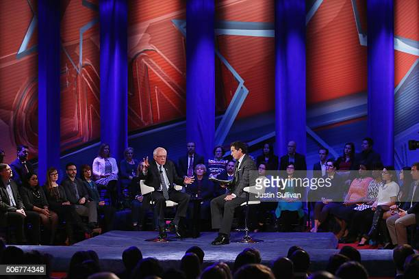 Democratic presidential candidate Senator Bernie Sanders speaks at a town hall forum hosted by CNN as moderator Chris Cuomo looks on at Drake...