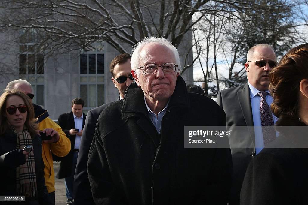 Democratic presidential candidate Senator Bernie Sanders (D-VT) walks through downtown Concord on election day on February 9, 2016 in Concord, New Hampshire. Sanders, who is expected to win over Democratic rival Hillary Clinton, greeted voters before taking a short walk where he was mobbed by members of the media.