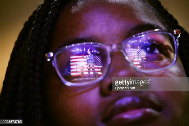 Democratic presidential candidate Senator Elizabeth Warren is reflected in a student's glasses as she speaks at a Get Out the Vote Rally at South...
