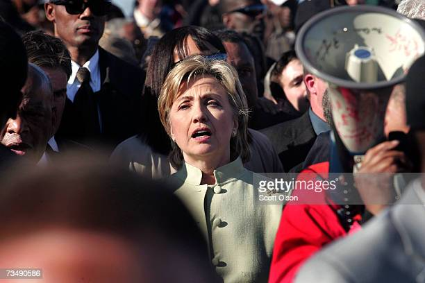 Democratic Presidential candidate Senator Hillary Clinton marches with a crowd to the Edmund Pettus Bridge to commemorate the 1965 'Bloody Sunday'...