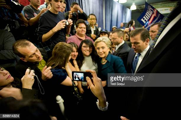 Democratic Presidential candidate Senator Hillary Clinton poses for photos with supporters during a campaign stop in Los Angeles at the IBEW...
