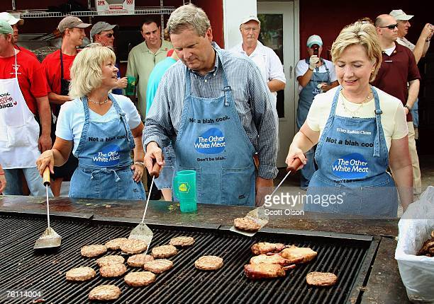 Democratic Presidential Candidate Senator Hillary Rodham Clinton cooks pork with former Iowa governor Tom Vilsack and his wife Christie at the Iowa...